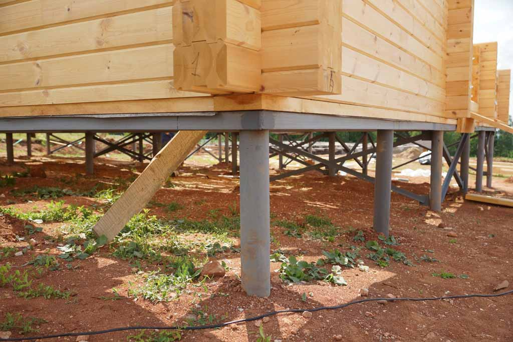 Выбираем недорогой вариант устройства фундамента для деревянного дома