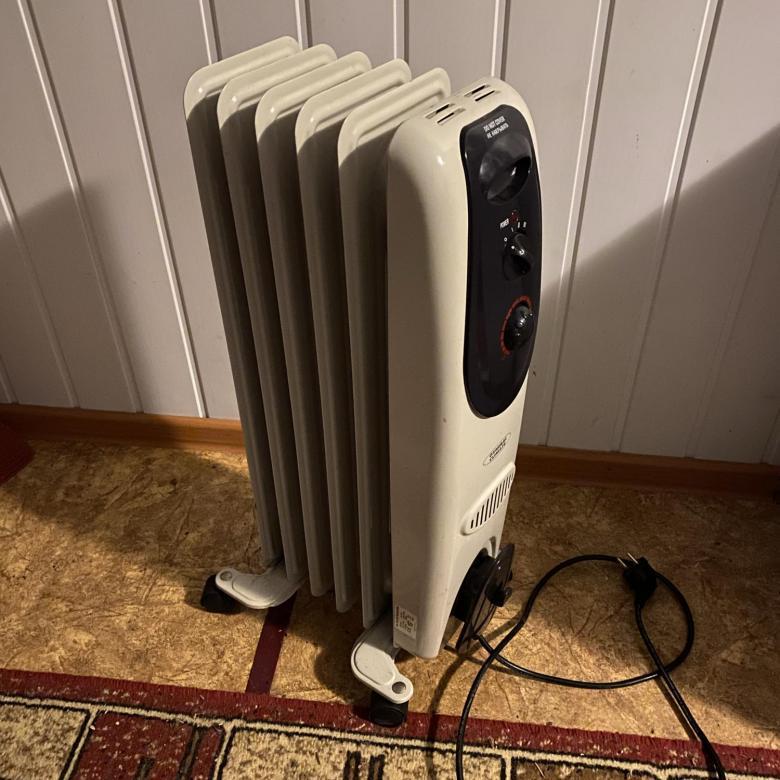Масляный радиатор отопления: как устроен и опасен ли в быту, сколько электроэнергии потребляет и почему он трещит